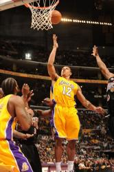 Shannon Brown puts up a layup inside.jpg