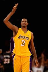 Trevor Ariza holds up 3 fingers.jpg