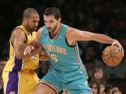 derek fisher defends stojakovic capt. .hornets_lakers_basketball_las107.jpg
