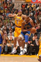 fisher tries to stop baron davis.jpg