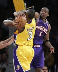 Ariza gets blocked by Amare Stoudamire.jpg