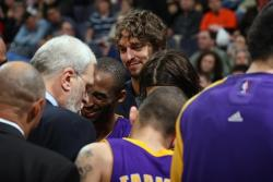 Gasol smiles while listening in on the Laker huddle.jpg