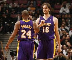 Paul Gasol and Kobe Bryant congratulate one another after a play.jpg