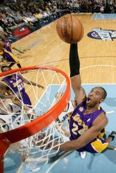 Kobe Bryant flies in for a slam dunk.jpg