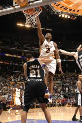 kobe dunks over tim duncan full.getty   spurs lakers 8 20 46 pm.jpg