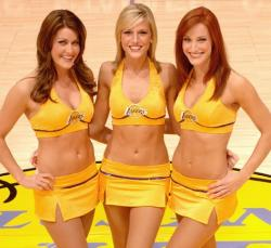 Three Laker Girls in short yellow skirt smile.jpg