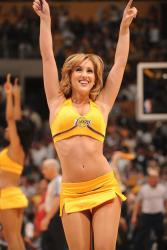 A Laker Girl puts her arms in the air.jpg