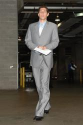 Luke Walton in a gray suit before the game.jpg
