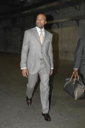 Derek Fisher arrives in a gray striped suit.jpg