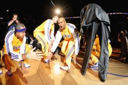 Derek Fisher gets low fives during pregame introduction.jpg