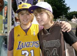Laker fans Dylan Sprouse and Cole Sprouse wearing Laker Jerseys.jpg