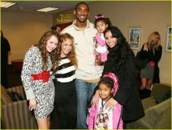 Kobe Bryant with Miley Cyrus and his wife Vanessa Bryant.jpg