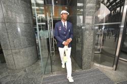 Kobe Bryant walks out of his hotel room in Beijing.jpg