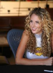 Laker Girl with long permed hair smiling.jpg