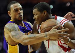 Shannon Brown guards Kyle Lowry tightly.jpg