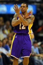 Shannon Brown makes a cross with his arms.jpg