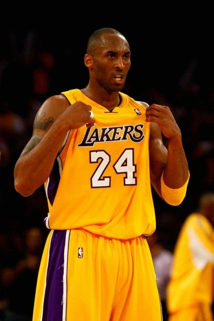 best service 4348d 23c1f Kobe Bryant tugs at his jersey during game one of the 2009 ...