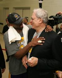 Kobe Bryant has a laugh with Phil Jackson during post game celebration.jpg