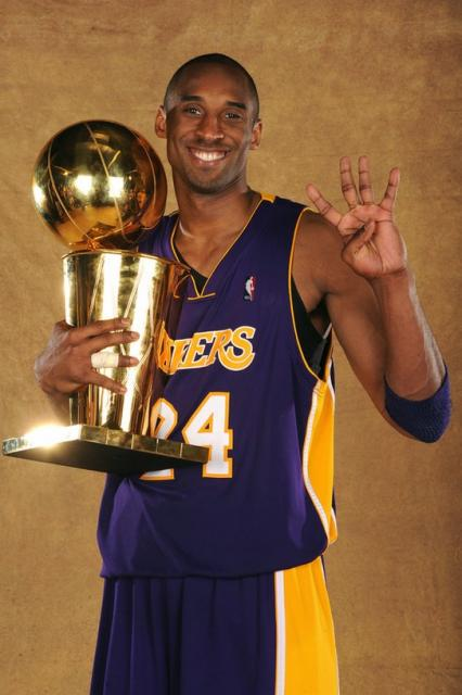 Bryant Larry holds 4 trophy the  Kobe and fingers O