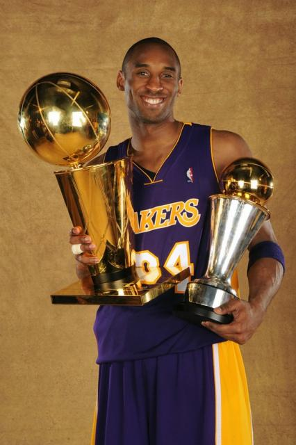 Kobe Bryant poses with both Larry O'Brien trophy and his ...