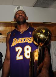 DJ Mbenga holds the 2009 NBA championship trophy.jpg