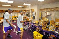 Lakers celebrate 2009 Championship in the locker room by letting loose champagne.jpg
