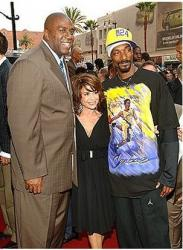 Magic Johnson with Paula Abdul and Snoop Dog.jpg