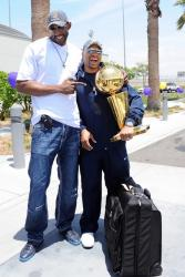 DJ Mbenga poses with Derek Fisher at the airport.jpg