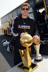 Luke Walton poses with the Larry O Brien trophy and the Finals MVP trophy.jpg