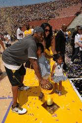 Vanessa Bryant and Kobe and daughters at the Lakers championship rally 2009.jpg
