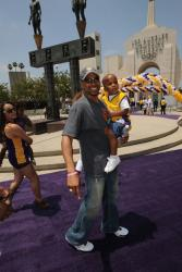 Derek Fisher holds his son at the Lakers championship rally 2009 in the Coliseum.jpg