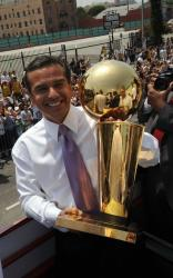 Los Angeles Mayor Antonio Villaraigosa holds the Lakers NBA championship trophy during the parade.jpg