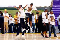 Shannon Brown and Trevor Ariza bump on stage during the Lakers championship rally 2009.jpg