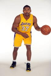 Ron Artest dribbling a basketball in a Lakers jersey.jpg