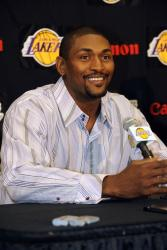 Ron Artest in a striped shirt listens to a question during his Lakers introduction.jpg
