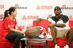 Ron Artest and Chinese hostess in China.jpg