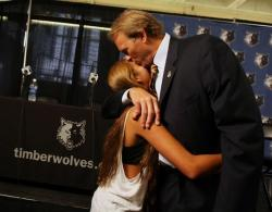 Kurt Rambis kisses his daughter Ali.JPG
