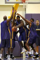 Ron Artest is triple teamed by fellow Laker teammates down low during practice.JPG