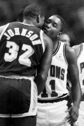 Black and white photo of Magic Johnson greeting Isiah Thomas.JPG
