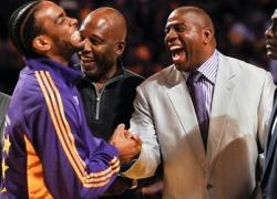 Magic Johnson has a big laugh as he shakes Josh Powell's hand.JPG