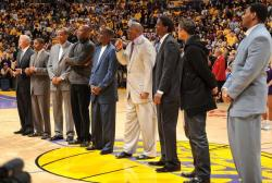 Magic Johnson on the microphone during 2009 opening night along with Jerry West, Norm Nixon, Wilkes, Worthy, Cooper, AC Green, R
