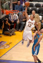 Shannon Brown uses Stojakovic and goes for for a monster dunk.JPG