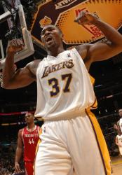 Ron Artest flexes his arms after making a bucket against Houston.JPG