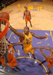 Josh Powell battles for a rebound inside vs the Suns.JPG