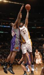 Josh Powell shoots a hook shot over Earl Clark.JPG