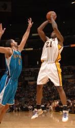 Josh Powell shoots a jumper over Peja.JPG