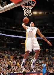 Shannon Brown flying one handed power dunk against Dallas.JPG