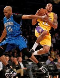 Shannon Brown drives past Vince Carter.JPG