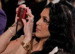Vanessa Bryant takes a photo with a red digital camera.JPG