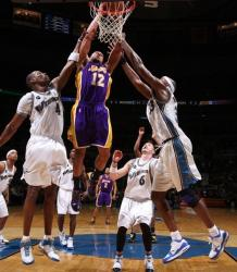 Shannon Brown dunks between Jamison and Haywood.JPG